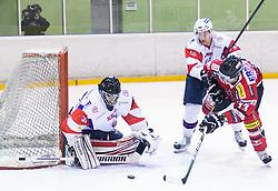 ROBERT KRISTAN of Slovenia vs Michael Schiechl of Austria during Friendly Ice-hockey match between National teams of Slovenia and Austria on April 19, 2013 in Ice Arena Tabor, Maribor, Slovenia.  Slovenia defeated Austria 5-2. (Photo By Vid Ponikvar / Sportida)