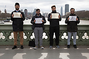 Thousands of people including police officers and Muslim faith leaders gathered on Westminster Bridge to hold a vigil and a minutes silence one week after the terror attack, on March 29th 2017 in London, United Kingdom. Young Muslims holding signs, one which reads Loyalty to my country is part of my faith.