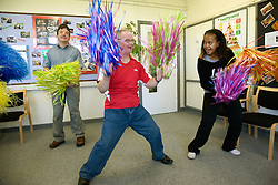 Group of Day Service users with learning disabilities doing cheerleading,