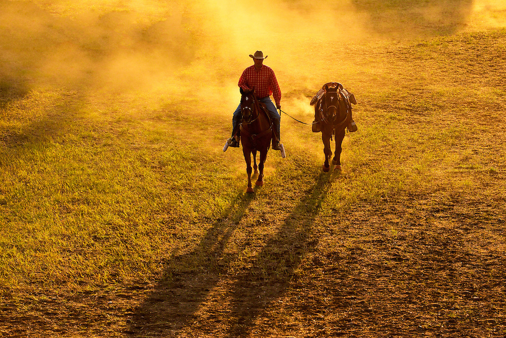 Cowboy leading a horse before the Chief Joseph Days Rodeo in Joseph, Oregon.
