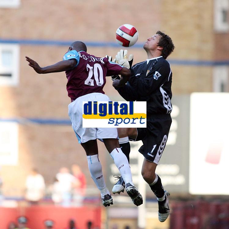 Photo: Chris Ratcliffe.<br /> West Ham United v Aston Villa. The Barclays Premiership. 10/09/2006.<br /> Thomas Sorensen (R) of Aston Villa clashes with Nigel Reo-Coker of West Ham.