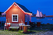 A red fish house against the fading twilight after sunset at Orrs Island, Maine.