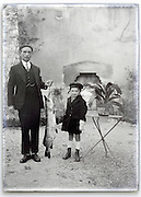 elderly man holding large fish with grandchild vintage 1900s