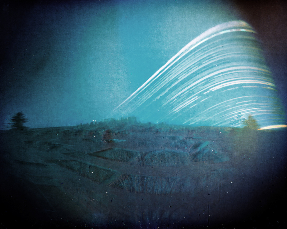 Calgary skyline solargraph. A 6 month long exposure. From winter solstice (lowest arc in the sky) till summer solstice (highest arc). Made with a DIY pinhole camera and a piece of photographic paper.