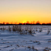 """""""Fire on Ice""""<br /> <br /> The beautiful orange and yellow hues from the setting sun, bring fire to the snow and ice in this lovely winter sunset!!<br /> <br /> Sunset Images by Rachel Cohen"""