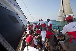 Artemis Racing (SWE) versus Synergy (RUS), RR1. Dubai, United Arab Emirates, November 14th 2010. Louis Vuitton Trophy  Dubai (12 - 27 November 2010) © Sander van der Borch / Artemis Racing