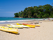 The beach at Punta Uva, Limon, Costa Rica, on a warm, pleasant day. Note: there is a topless woman on the beach.