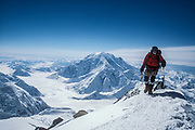 Mt Foraker behind climber above Kahiltna glacier, ski expedition to travserse Denali, Mt McKinley, Alaska