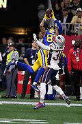Los Angeles Rams wide receiver Josh Reynolds (83) leaps in the air while trying to catch a second quarter pass broken up by New England Patriots cornerback Jason McCourty (30) on a third down play during the NFL Super Bowl 53 football game on Sunday, Feb. 3, 2019, in Atlanta. The Patriots defeated the Rams 13-3. (©Paul Anthony Spinelli)