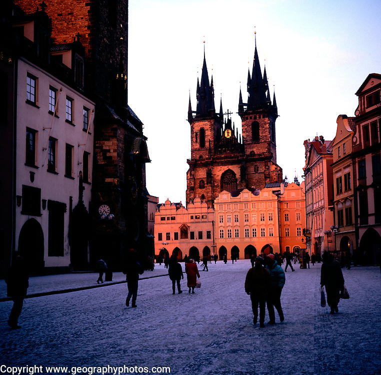Old town square Tyn church at sunset in winter, Prague, Czech republic
