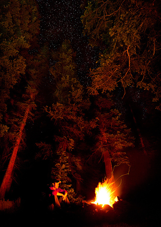 Relaxing by the campfire in a Colorado forest. The extended solitude I find in wilderness frees my mind to reflect and meander in ways not possible within the familiar distractions of civilization.