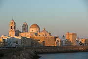 View of waterfront and historical buildings including Cadiz Cathedral, Cadiz, Andalusia, Spain