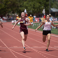 Rehoboth Lynx Naomi Philips, center left, competes in the 100 meter dash at the NMAA 2A track and field state finals in Albuquerque Friday.
