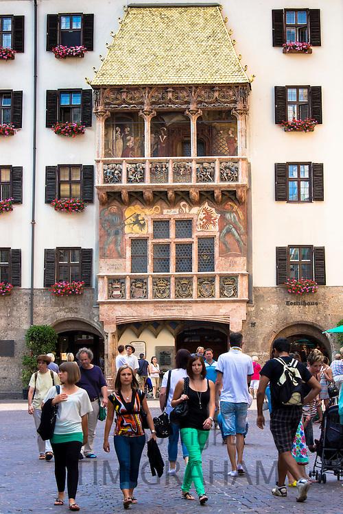 Tourists at Goldenes Dachl, Golden Roof, built 1500 of gilded copper in Herzog Friedrich Strasse, Innsbruck the Tyrol Austria