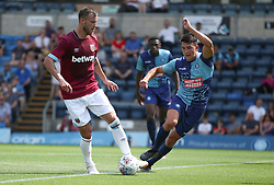 West Ham United's Andriy Yarmolenko is challenged by Wycombe Wanderers Luke O'Nein during a pre-season match at Adams Park, Wycombe.