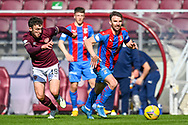 Sean Walsh (#4) of Inverness Caledonian Thistle FC runs past Andy Irving (#19) of Heart of Midlothian FC during the SPFL Championship match between Heart of Midlothian and Inverness CT at Tynecastle Park, Edinburgh Scotland on 24 April 2021.