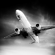 A cargo jet lowers the landing gear on approach to YVR.<br /> <br /> Photo: © Rod Mountain<br /> <br /> http://www.rodmountain.com