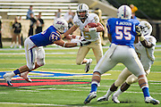 Dec 1, 2012; Tulsa, Ok, USA; University of Central Florida Knights quarterback Blake Bortles (5) runs past Tulsa Hurricanes defensive end Cory Dorris (93) as linebacker Shawn Jackson (55) defends during a game at Skelly Field at H.A. Chapman Stadium. Tulsa defeated UCF 33-27 in overtime to win the CUSA Championship. Mandatory Credit: Beth Hall-USA TODAY Sports