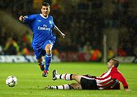 Photograph: Scott Heavey.<br />Southampton v Chelsea. FA Barclaycard Premiership. 22/11/2003.<br />Adrian Mutu skips over the challenge of Danny Higginbotham