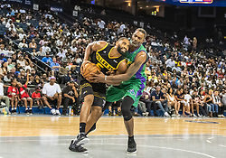 July 6, 2018 - Oakland, CA, U.S. - OAKLAND, CA - JULY 06: Qyntel Woods (6) of 3 Headed Monsters grapples Alan Anderson (6) of the Killer 3s for the ball during game 4 in week three of the BIG3 3-on-3 basketball league on Friday, July 6, 2018 at the Oracle Arena in Oakland, CA  (Photo by Douglas Stringer/Icon Sportswire) (Credit Image: © Douglas Stringer/Icon SMI via ZUMA Press)