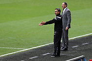 David Wagner, the manager of Huddersfield Town (l) and Swansea city manager Paul Clement look on from the touchline. Premier league match, Swansea city v Huddersfield Town at the Liberty Stadium in Swansea, South Wales on Saturday 14th October 2017.<br /> pic by  Andrew Orchard, Andrew Orchard sports photography.