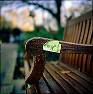 UK. London. The Village Green: From Blair to Brexit.<br /> A story on the relationship between the Media, Politicians and the public as they come together on College Green, a small patch of land next to The Houses of Parliament in Westminster. <br /> Photo shows a visitor's day pass to The Houses of Parliament stuck to a bench next to College Green, around the time of the 2005 General Election.<br /> Photo ©Steve Forrest/Workers' Photos