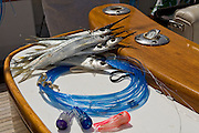 Pile of rigged horse ballyhoo with blue monofilament and mini chugger heads.