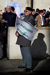 © Licensed to London News Pictures. 07/02/2017. London, UK. A former Royal Marines holds a banner outside the Royal Courts of Justice in London, to show support for Sgt Blackman, who is due to start an appeal against his life sentence for the murder of a wounded Taliban fighter in Afghanistan in 2011.  Photo credit: Ben Cawthra/LNP