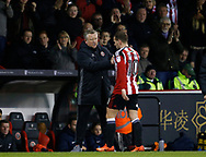 Chris Wilder manager of Sheffield Utd greets Billy Sharp of Sheffield Utd as he is subbed during the English League One match at Bramall Lane Stadium, Sheffield. Picture date: April 5th 2017. Pic credit should read: Simon Bellis/Sportimage