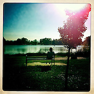 A woman looks out over a lake, where I often walked with Quinn.