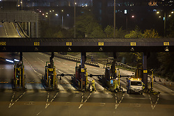 @Licensed to London News Pictures 28/11/2014. Dartford Crossing, South Orbital Road, Dartford, Kent. The first phase of barrier removals start in the early hours of today 29/11/2014. Payment booths at the Dartford Crossing will be removed and replaced with a remote charging system known as Dart Charge. Photo credit: Manu Palomeque/LNP