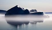 Iceberg in fog near Humboldt Glacier, Kane Basin, Nares Straight, Greenland.