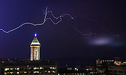Lightning fills the skies near the Smith Tower in the early morning hours as seen from the Harborview Park Viewpoint. Lightning strikes were recorded across the greater Seattle area late treating those still awake to a spectacular light show. (Lindsey Wasson / The Seattle Times)