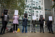 Campaigners hold up placards for a Close Napier Barracks demonstration outside the Home Office headquarters on Marsham street on the 28th September 2021 in London, United Kingdom. Napier Barracks has been used by the Home Office to house Asylum seekers for a year now. Close the Camps organised a solidarity demo for the people in Napier Barracks, there have been numerous calls for the camp to close as the facilities have been deemed unsafe for habitation and unfit for purpose.