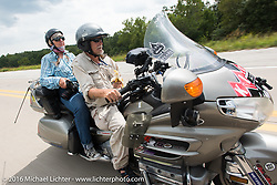 Felicia Morgan taking photographs from the pillion of Joe Sparrow's Honda Gold Wing during Stage 6 of the Motorcycle Cannonball Cross-Country Endurance Run, which on this day ran from Cape Girardeau to Sedalia, MO., USA. Wednesday, September 10, 2014.  Photography ©2014 Michael Lichter.
