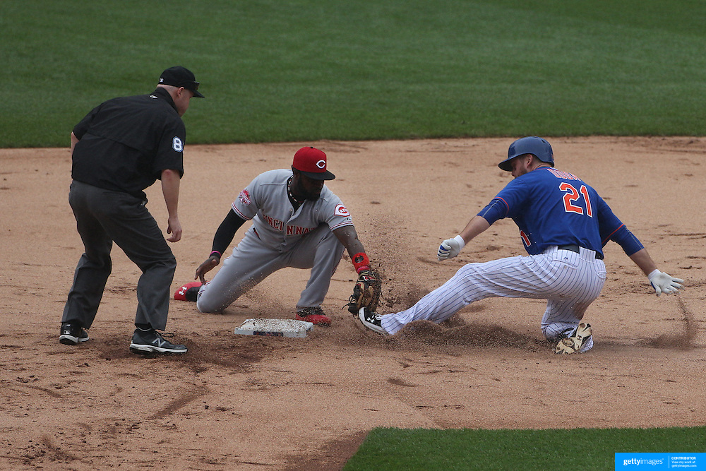 Lucas Duda, New York Mets, running to second on a hit  as Brandon Phillips, Cincinnati Reds, applies the tag during the New York Mets Vs Cincinnati Reds MLB regular season baseball game at Citi Field, Queens, New York. USA. 28th June 2015. Photo Tim Clayton