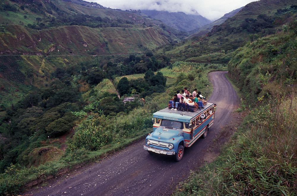 Chiva (brightly painted bus) winds its way through Tierradentro, Cauca.
