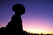 Silhouette of Balanced Rock at dusk, Arches National Park, Utah USA