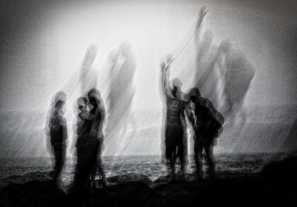 Ghostlike alien figures on the beach