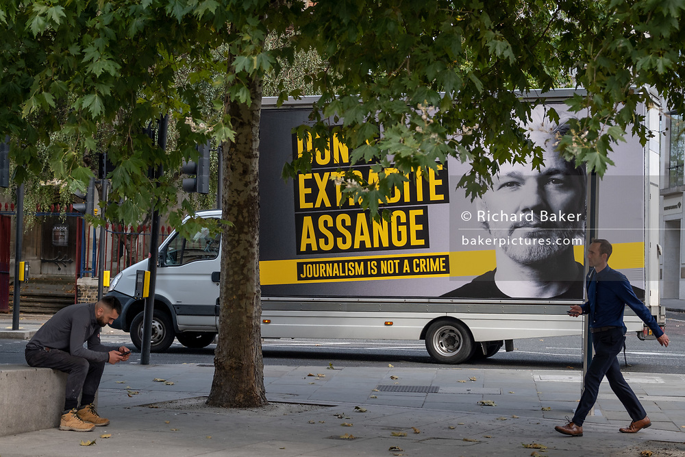 A travelling billboard drives through central London in support of Wikileaks founder Julian Assange  during a protest outside London's Old Bailey court as his fight against extradition to the US has resumed, on 16th September 2020, in London, England. Assange has been in Belmarsh Prison for 16 months and is wanted over the publication of classified documents in 2010 and 2011. If convicted in the US, he faces a possible penalty of 175 years in jail.