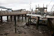 Low tide on the River Thames at Nine Elms Pier in Battersea on 1st February 2020 in London, England, United Kingdom. Nine Elms is an area within Battersea in South West London. The area was formerly mainly industrial but is now becoming more residential and commercial in character.