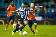 Massimo Luongo of Sheffield Wednesday goes past Tom Davies of Everton  during the EFL Cup match between Sheffield Wednesday and Everton at Hillsborough, Sheffield, England on 24 September 2019.