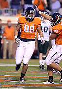 Oct 23, 2010; Charlottesville, VA, USA;  Virginia Cavaliers tight end Paul Freedman (88) celebrates a touchdown with Virginia Cavaliers tight end Colter Phillips (89) during the game against the Eastern Michigan Eagles at Scott Stadium.  Virginia won 48-21. Mandatory Credit: Andrew Shurtleff