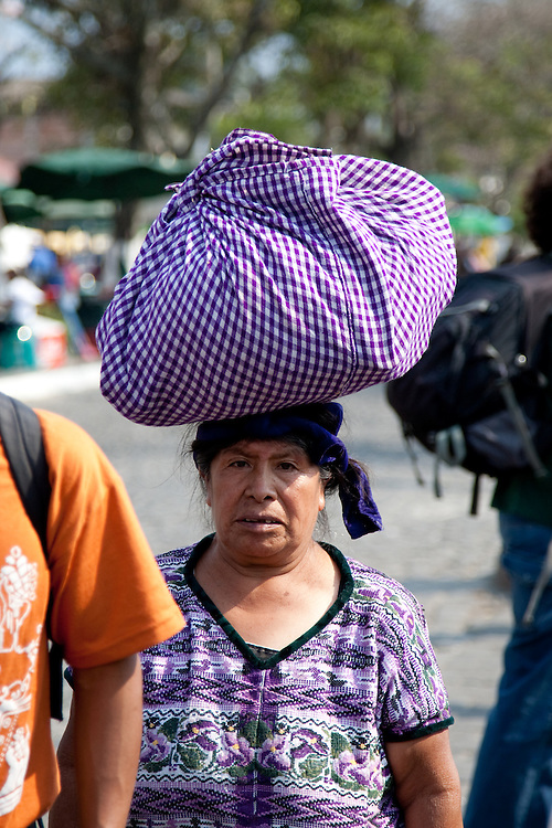During Catholic religous festival Semana Santa, with parades and cspets of flowers Street Photography of people of Antigua, Guatemala, Central America. These photographs depict the few of the people who weren't tourists.These include children working as shoe shiners, young girls selling traditional bracelets and bags, and some people begging.