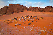 Red sand dunes and sandstone cliffs in Wadi Rum, Jordan.
