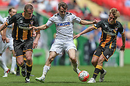 Rob Purdie (Hereford FC) goes between two Morpeth Town defenders during the FA Vase match between Hereford and Morpeth Town at Wembley Stadium, London, England on 22 May 2016. Photo by Mark Doherty.