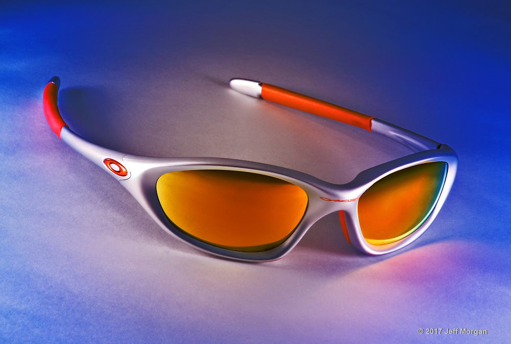 Oakely sunglasses on table.