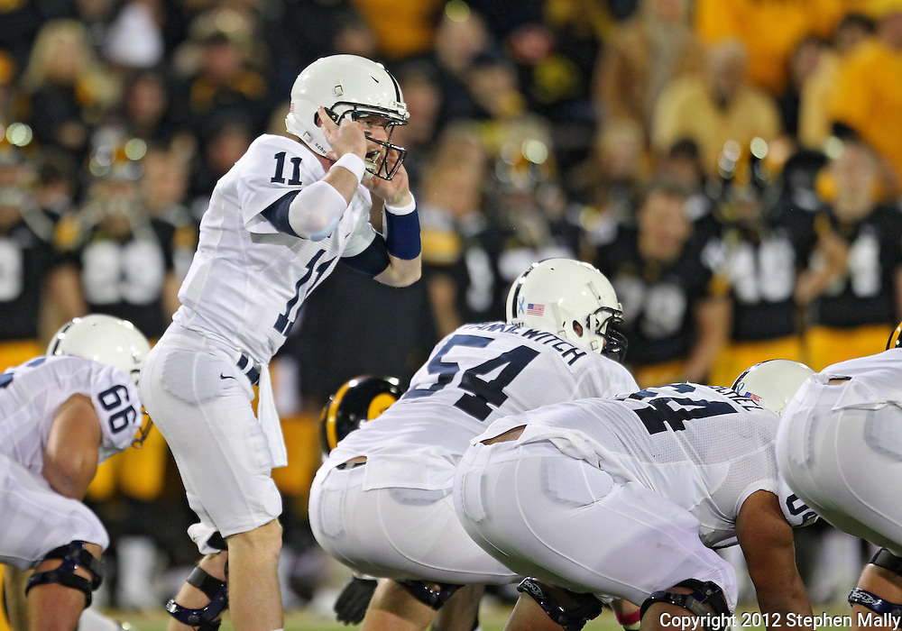 October 20 2012: Penn State Nittany Lions quarterback Matthew McGloin (11) motions to his team during the first half of the NCAA football game between the Penn State Nittany Lions and the Iowa Hawkeyes at Kinnick Stadium in Iowa City, Iowa on Saturday October 20, 2012. Penn State defeated Iowa 38-14.