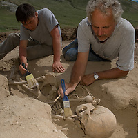 MONGOLIA. Smithsonian archaeologist & forensics specialist, Dr. Bruno Frohlich, & Amgalantugs Tsend, a Mongolian archaeology student, unearth bronze-age skeleton at site above Delger River near Muren.  Skeleton may be 2700+ years old.  <br /> <br /> #MS0702_060629_0062.NEF