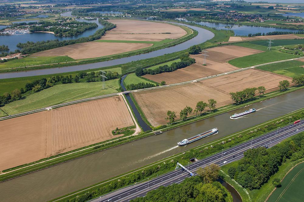 Nederland, Limburg, Gemeente Maasgouw, 27-05-2013; scheepvaart op het Julianakanaal bij Ohe en Laak. Grensmaas in de achtergrond, autosnelweg A2 in de voorgrond.<br /> Shipping on Julianacanal (Meuse canal).<br /> luchtfoto (toeslag op standard tarieven);<br /> aerial photo (additional fee required);<br /> copyright foto/photo Siebe Swart.